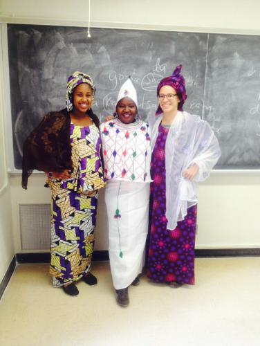 Three students dressed for a Hausa/Fulani occasion