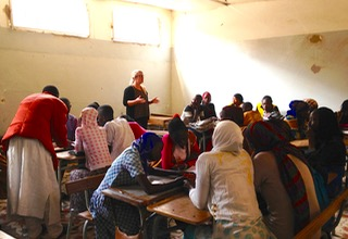 A woman teaching students in a Senegalese classroom