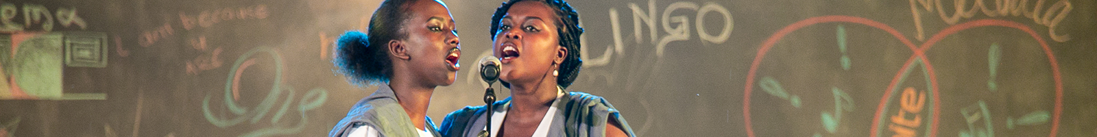 Two women singing at the Ubumuntu Arts Festival in Kigali