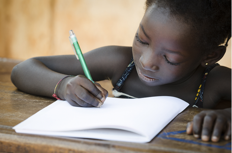 A child writing in a notebook