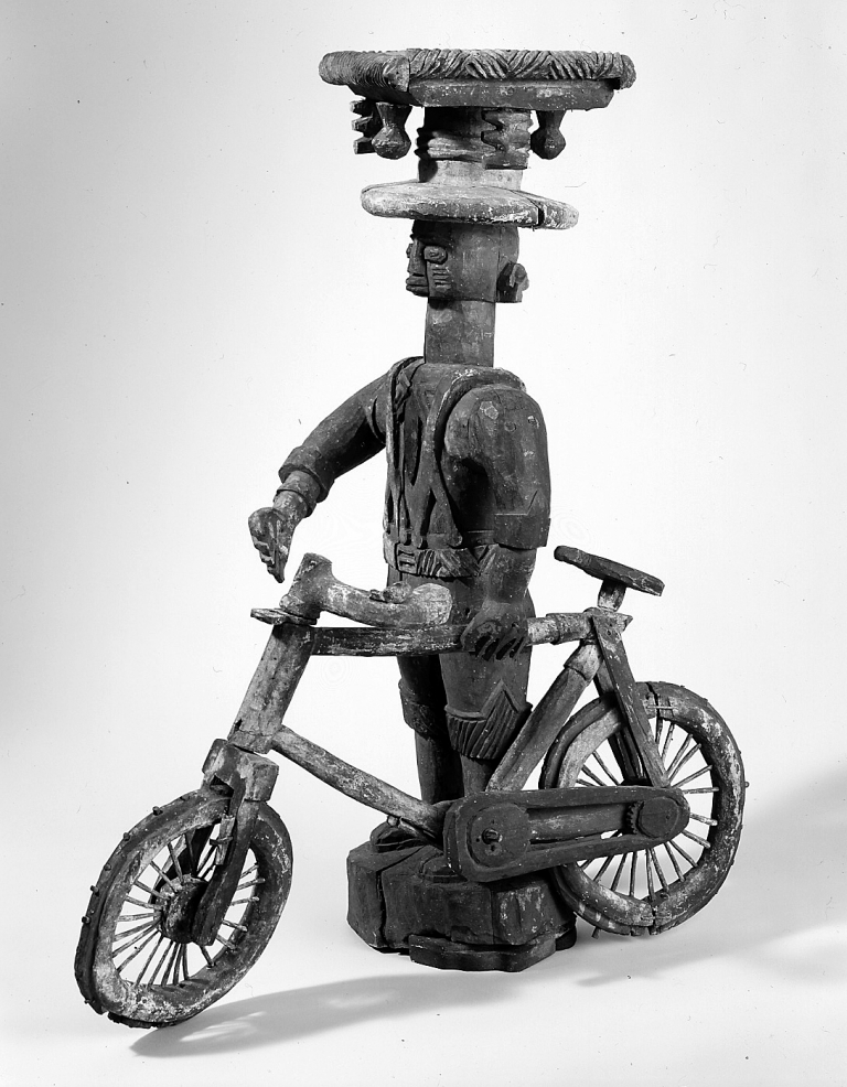 """""""Man with a Bicycle"""" a Yoruba sculpture from the 20th century"""